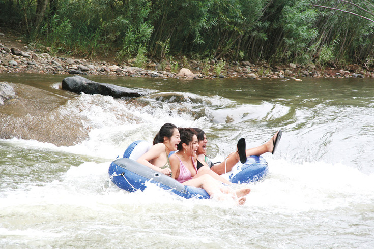 Denver resident Nahomi Mendoza, 19, center, floats down Clear Creek in Golden with two of her friends on July 29. Mendoza has been tubing on Clear Creek before and believes it is pretty safe. But she and her friends are strong swimmers, she added, and would recommend that any child use a life jacket.