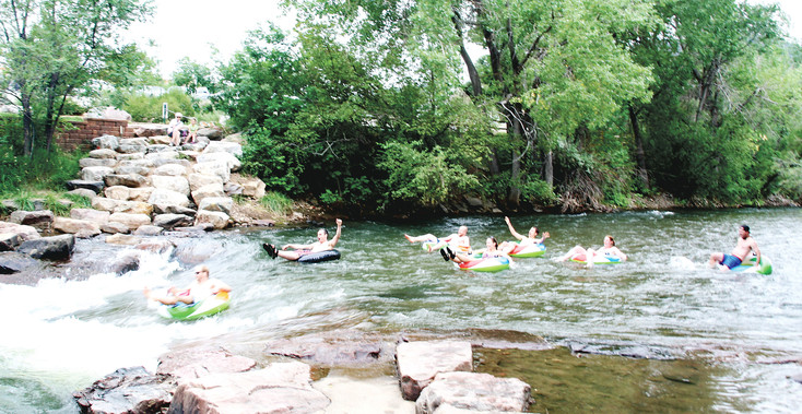 A wedding party consisting of about 50 people from all over the world floats down Clear Creek in Golden July 24, 2015. Tubing is a popular recreational activity, but proper safety measures should be taken to ensure both safety and fun.