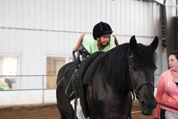 Dillon Waytt practicing vaulting at the Arvada Indoor Equestrian Center's Horses and Neigh-ture camp.