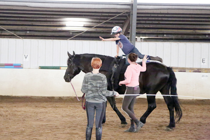 Hayden Parker practicing vaulting, one of the actives at the horse camp.