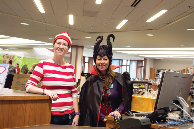 Hannah Gross, dressed as Waldo, and Mary Armstrong, dressed as Malificent, are library specialists who worked at Koelbel Con at the Koelbel Library on July 30.