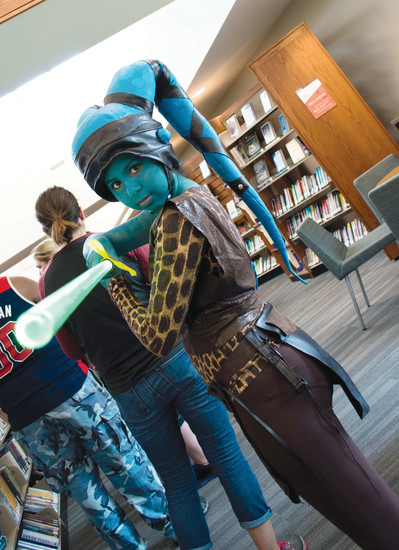 "Hannah Girgis dressed as an Aylasecura from ""Star Wars"" at Koelbel Con at the Koelbel Library on July 30."