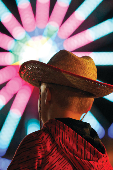 Sawyer Klain, 7, checks out the view at the first night of the Douglas County Fair and Rodeo. Admission was free for the annual event's first night, featuring the Professional Rodeo Cowboys Assoication's Xtreme Bulls competition.