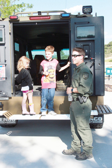 Isaiah Farnham, 6, who wants to be a police officer when he grows up, gets an inside look at law enforcement vehicles during the National Night Out event in Castle Rock.