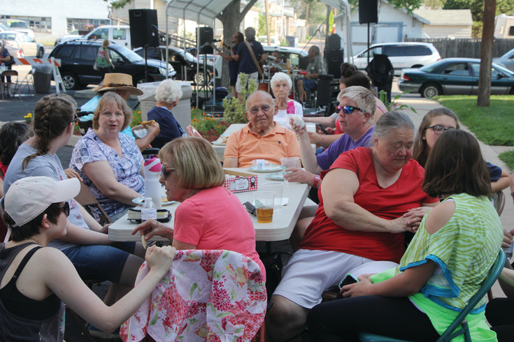 Some of the people who attended the Aug. 1 National Night Out gathering at the Spirit of Hope United Methodist Church meet and greet each other. This year, Immanuel Lutheran Church joined with Spirit of Hope hosting the event that included activities for the children, food and a live band. There were 32 National Night Out gathering in Englewood.