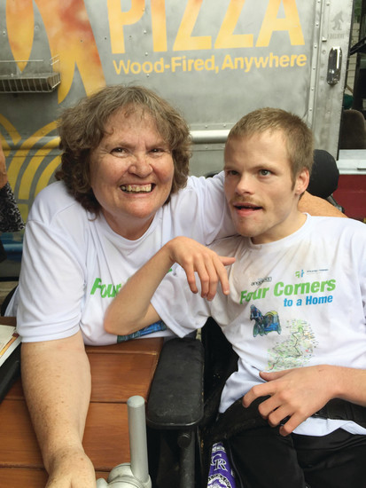 Cindy and PJ Snyder smile and enjoy the company at a Golden beer garden on July 30, after the completion of PJ's 600-mile bike ride, which Cindy drove the support vehicle.