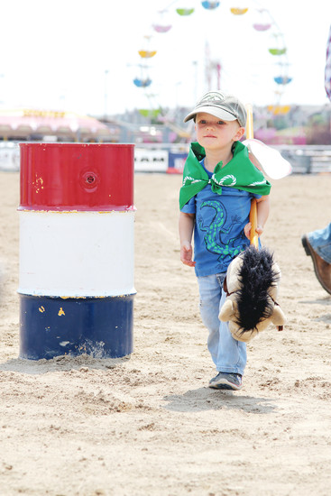 Cooper Lamb, 2, of Parker turns a barrel during the stick horse rodeo at the Douglas County Fair and Rodeo on Aug. 5.