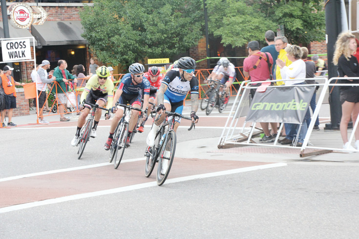Riders use skill and balance to make the 90-degree turns in the course during the Aug. 5 Littleton Twilight Criterium. There were six races on the L-shaped course that covered 8/10th of a mile. A criterium is a timed event with riders making as many laps as possible during the time limit.