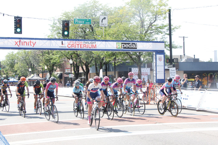 The 22 competitors in the Senior Women's category leave the starting line in the first of the six races that made up the Aug. 5 Littleton Twilight Criterium. A total of about 450 racers guided their bikes around the L-shaped course during the full day of racing action.