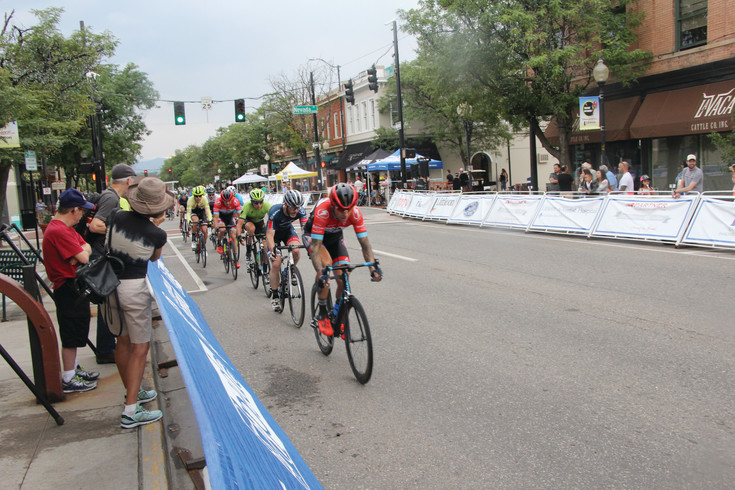 Riders form an almost arrow-straight line as they speed down Main Street during the Aug. 5 Littleton Twilight Criterium. A criterium is a timed event and riders push the pace in the later laps, hitting speeds of about 30 miles an hour.