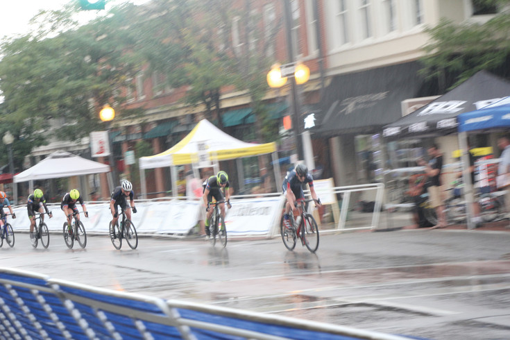 Rain fell during the senior men's category race at the Aug. 5 Littleton Twilight Criterium. Racers ignored the rain early but when rain got heavier the action was suspended for about 30 minutes. When the rain slacked off, action resumed and the racers continued pushing the pace.
