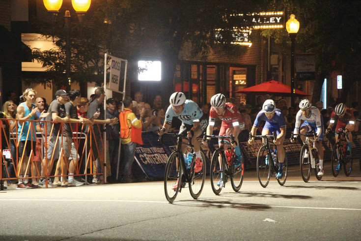 The final race of the Littleton Twilight Criterium was the men's professional category that was run under the lights. Streetlights and lights from businesses illuminated the track, but special lights were placed at the corners and at the start-finish line.