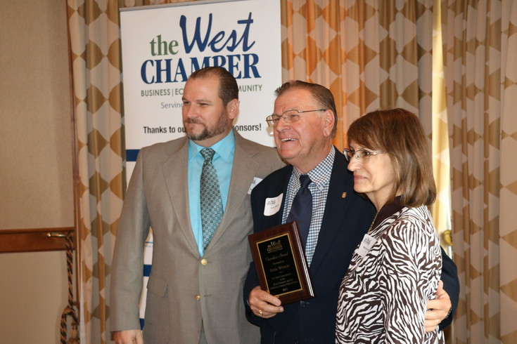 Ernie Witucki, a member of The West Chamber who started its hall of fame program, poses with his son, Doug, and his wife, Marsha, on Aug. 3 after receiving special recognition for his efforts to launch the program.