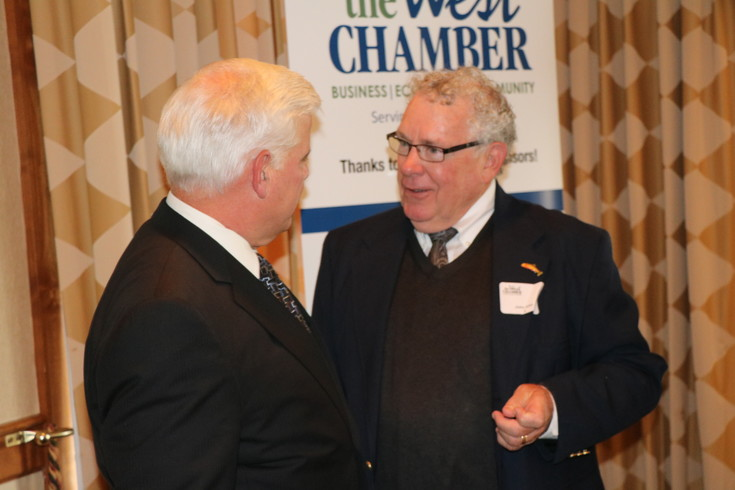 Greg Stevinson, left, and John Ellis, right, visit after both were inducted into The West Chamber's Hall of Fame on Aug. 3