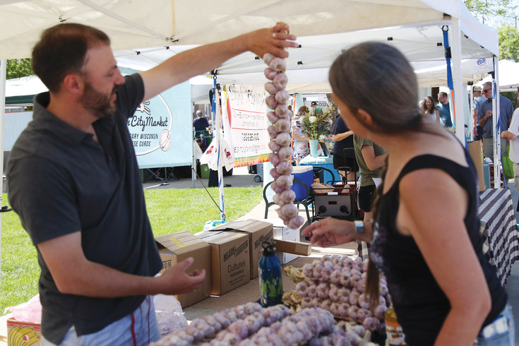 Nathan Mudd sells volcanic organic garlic braids at the market. The braids last about a year.