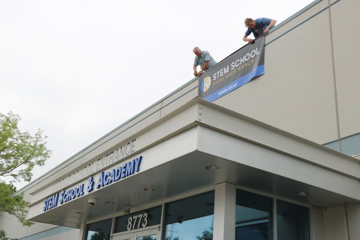Temporary banners are placed on what used to be called STEM School and Academy. The K-12 charter school, now called STEM School Highlands Ranch, got a new name and logo over the summer.