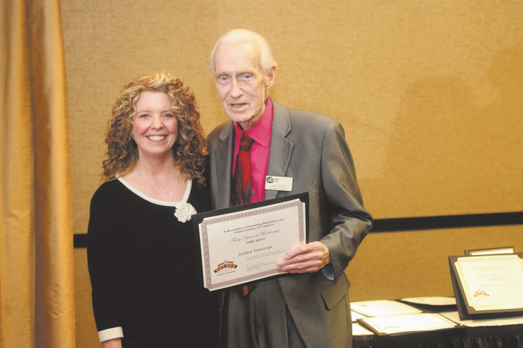 John Tracy poses with Kelly Jackson Condon after she presented him with the Chairman's Award at a Golden Chamber of Commerce luncheon
