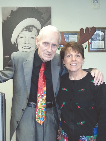 John Tracy and co-worker Carla Bethke show off their Christmas attire during the 2015 holiday season in the Golden Transcript office.