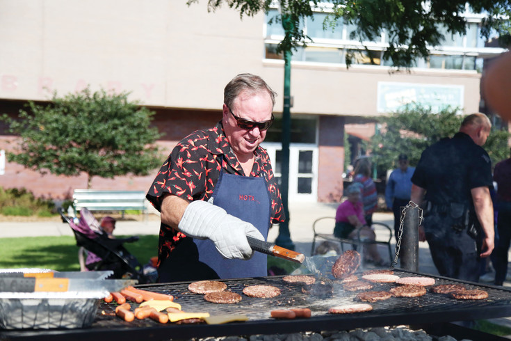 Arvada Mayor Marc Williams mans the grill during the community celebration.