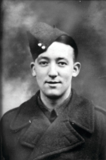 A photo shows the young Private Christopher John Carpenter of 48th Regiment of the British Army, taken near the beginning of World War II. Carpenter survived the Dunkirk rescue and served in the American Red Cross after being honorably discharged from the British Army.