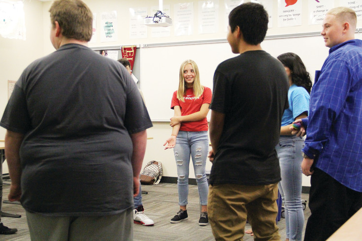 Two Link Crew leaders oversaw a group of about 10 freshmen during small-group activities in a classroom at Englewood High School's first day of the academic year Aug. 10. The students answered questions to get to know each other.