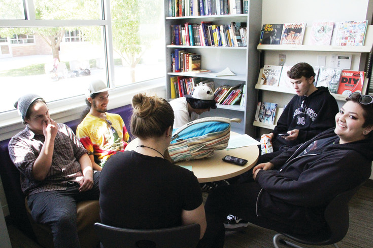 A few students sit in the student-run library at Colorado's Finest High School of Choice on the first day of school in Englewood Aug. 10. The high school includes students up to age 21 who have struggled in other high schools or have risk factors that may make school more of a challenge.