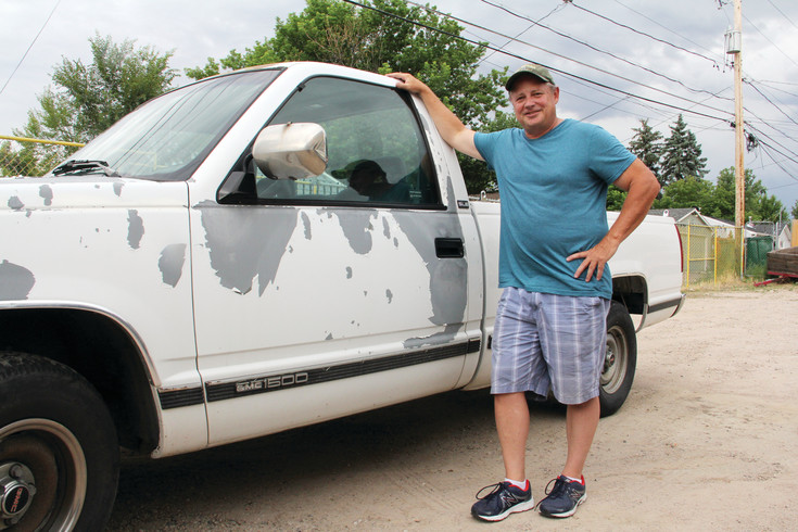 "Bart Sayyah, executive director of the Helping Our People Excel (HOPE) nonprofit, poses next to what he said is his ""beat-up, 1997, 200,000-mile plus pickup truck,"" which he drives to pick up food from sources like grocery stores and Food Bank of the Rockies. Sayyah comes back to the HOPE food pantry with up to 1,200 pounds of food, he said."