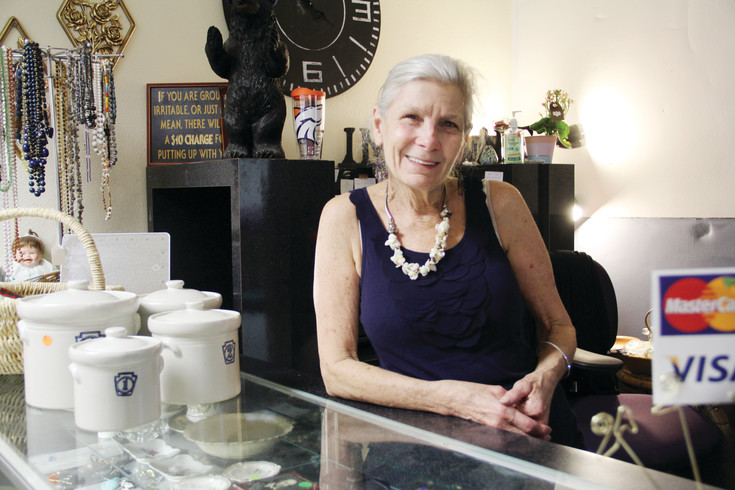 "Barbara ""Bobbi"" Marshall poses at the checkout counter at HOPE's Attic thrift store July 28. Marshall, 75, came to the store and HOPE pantry first as a customer and pantry client, became a volunteer and then earned the title of store manager."