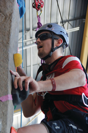 Nate Redman, 25, scales the adaptive climbing wall at the Parker Fieldhouse on Aug. 9. Redman has been coming to the facility to climb since April, and has made it to the top of the 25-foot structure twice, so far.