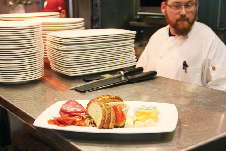 An arranged plate of bread and cheese sits in the kitchen at West 29th Restaurant and Bar Aug. 8. Chris Johnson, a student in the ACFCCA apprenticeship program, prepared the plate.