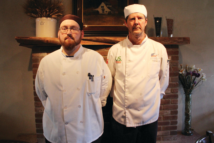 Cory Matthews, 31, executive chef at West 29th Restaurant and Bar in Wheat Ridge, stands next to Chris Johnson, 56, a student in the ACFCCA apprenticeship program Aug. 8. The restaurant is a sponsor house, a location that participates in mentoring apprentices for the ACFCCA's program.
