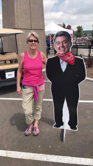 Sue Zloth stands next to a cardboard cutout of Sen. Cory Gardner at the Douglas County Fair and Rodeo on Aug. 6.