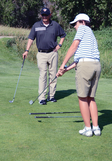 Lakewood golf coach Alan Gonzales, left, watches senior Jack Castiglia during the first week of practice. Castiglia is one of the favorites to win the Class 5A Jeffco League boys golf individual title.