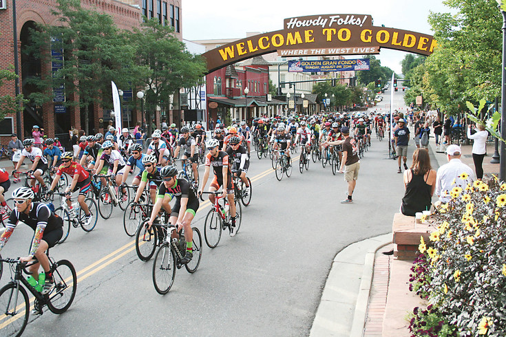 Golden Gran Fondo participants take off last year underneath the welcome arch in downtown Golden. This year, the bike race begins at 8 a.m. Aug. 27, with a finish at Parfet Park, located at 10th Street and Washington Avenue.  COURTESY PHOTO