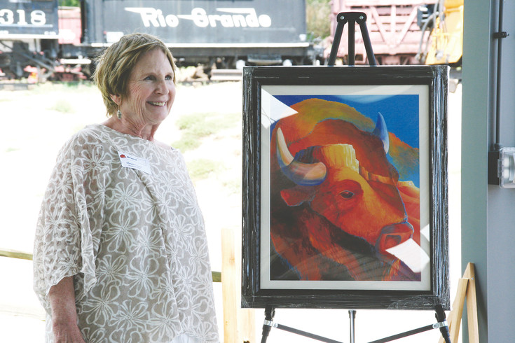 "Golden Mayor Marjorie Sloan unveils the 2017 Golden Fine Arts Festival poster on July 27. Titled ""Golden Buffalo,"" the Golden Chamber commissioned the design of it to local artist Jesse Crock. The design will be available to purchase as a poster or T-shirt at the Golden Fine Arts Festival on Aug. 19 and 20."