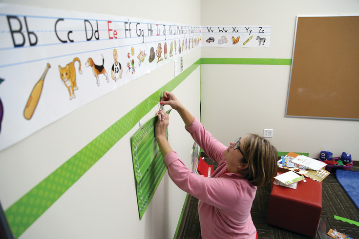 Jennifer Dahman sets up her kindergarten classroom at Three Creeks K-8 in Arvada in the weeks before school starts.