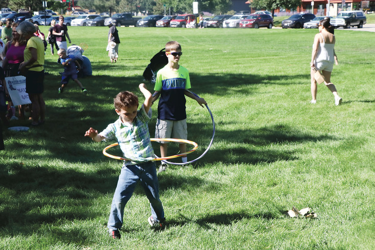 Roman Batron, 5, keeps going as he takes part in the Hula Hoop competition that was one of the Aug. 13 Western Welcome Week's Kid's Game of Old activities. Batron then joined his twin brother Noah to take part in the Bruce Wolf Stick Horse Stampede. The stampede, games of old and the pancake breakfast were held on the Arapahoe Community College campus.