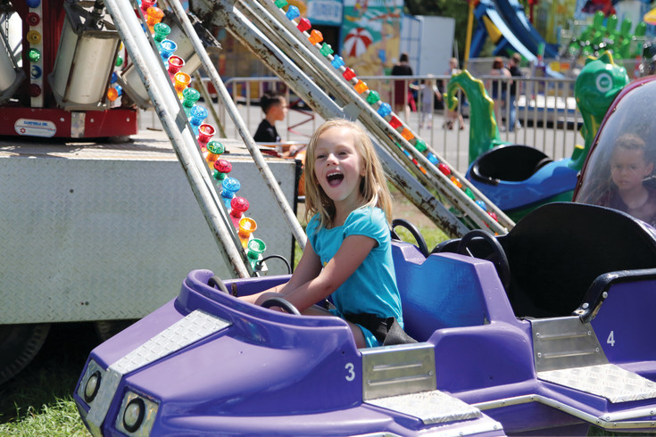 Vida Rimbert, of Arvada, enjoys a carnival ride at the Carnation Festival.