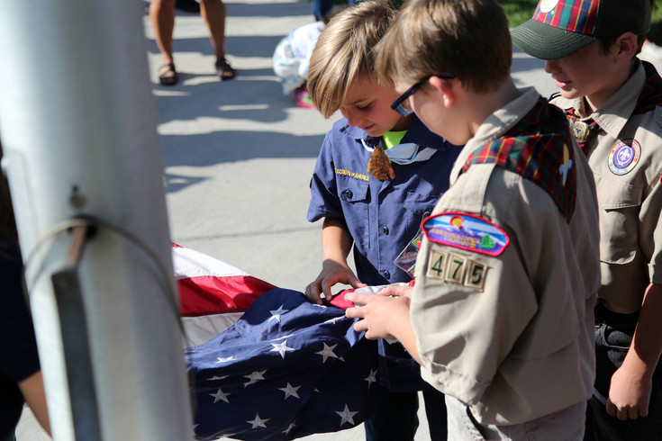 Scouts in Pack 475 raised both the American and Colorado flag before school started.