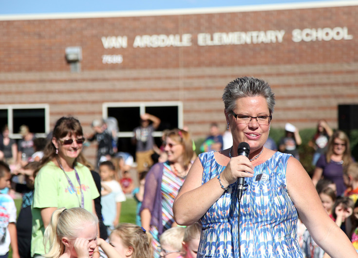 Van Arsdale Elementary School Principal Susan Chapla welcomes students and teachers for the first day of school on Aug. 17.