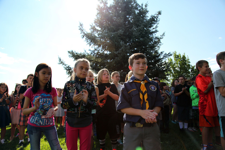 Students watch as the first day if school rockett takes flight at Van Arsdale Elementary in Arvada.