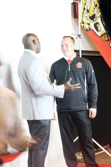 Hall of Fame running back Terrell Davis talks with Castle View football coach Dustin Pfeiffer prior to Davis' speech to the Castle View Gridiron Club's Back the Cats fundraising event on Aug. 18 at the Plum Creek Church in Castle Rock.