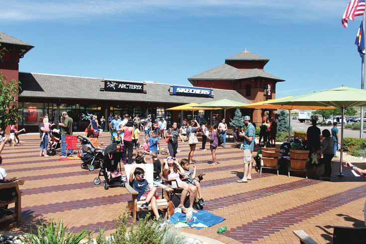 Solar eclipse spectators gathered at the Outlets at Castle Rock on Aug. 21, pulling up lawn chairs and spreading picnic blankets to enjoy the event.