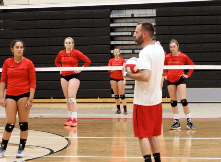 Castle View girls volleyball coach Scott Dowis offers some advice to his team during a Sabercats' practice session on Aug. 16. Castle View does a lot of 6-v-6 work and drills during its practices The Sabercats were ranked just outside the Top 10 in 12th place in the preseason CHSAA-Now Class 5A volleyball poll.