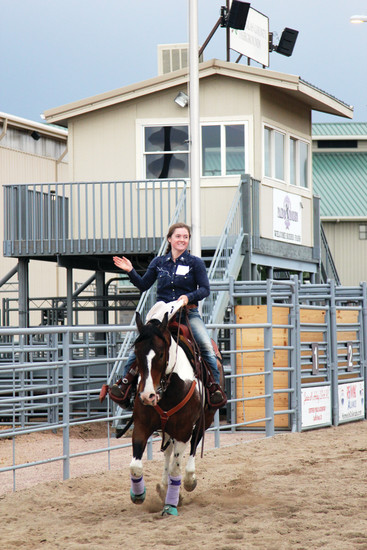 Olivia Ary, who was crowned as the 2018 Rodeo Royalty Queen, practices a fast lap around the arena during a July practice held ahead of the rodeo royalty competition.