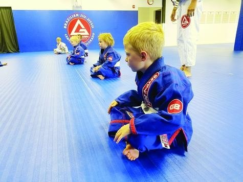 "Kids as young as 5 years old attend a Gracie Barra Centennial Jiu-Jitsu class, where they learn discipline and self defense. The young students fill out cards before each class to track their progress and receive colored belts when they hit a milestone in the program. ""To keep kids involved,"" said studio owner Robert Goodloe, ""they need to see progression."""