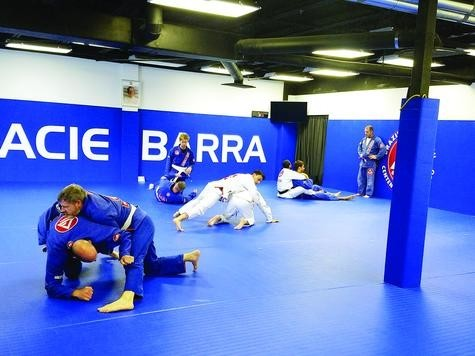 Adults practice self defense moves at a Gracie Barra Centennial Jiu-Jitsu class, held at 4181 East County Line Road. The month-long program teaches discipline and builds strength.