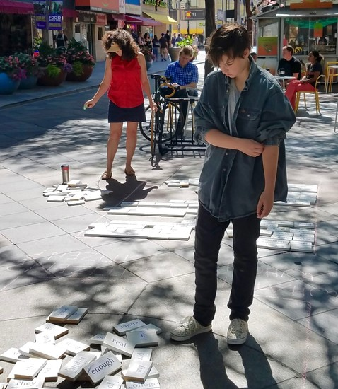 "Columnist Andrea Doray and writing student Grayson Sarsen contemplate their next sentences at Lighthouse Writers Workshop's ""Write Denver: Meet in the Street"" on the 16th Street Mall, Saturday, August 19."