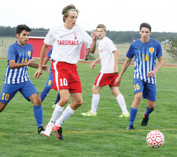 Tyler Whitley moves up to take a shot on goal for Elizabeth during the Aug. 24  soccer game against Wheat Ridge. Whitley scored a pair of goals for the Cardinals but Wheat Ridge won the game, 4-3 in overtime.