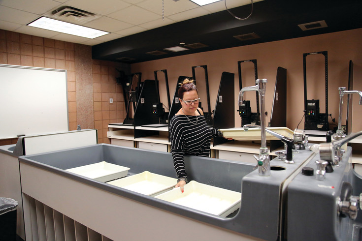 Suzi Melly, teacher at Horizon High School in Thornton, sets up the darkroom in her photography lab.
